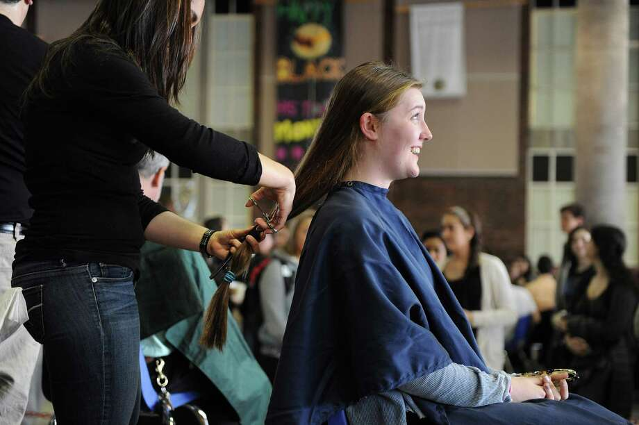Freshman Leah Common has about a foot of her hair cut for a fundraiser to benefit the St. Baldrick's Foundation by at Greenwich High School on Monday March 17, 2014. Photo: Dru Nadler / Stamford Advocate Freelance