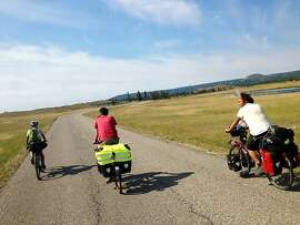 Yellowstone National Park, July 2013. Bike travelers ride together after sharing meals and stories at a Hiker/Biker Campsite.