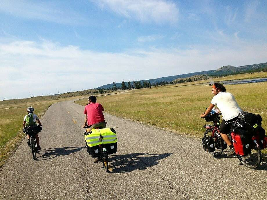 Bike travelers ride together after sharing meals and stories at a Yellowstone National Park hiker/biker campsite in July. Photo: Ellie McCutcheon