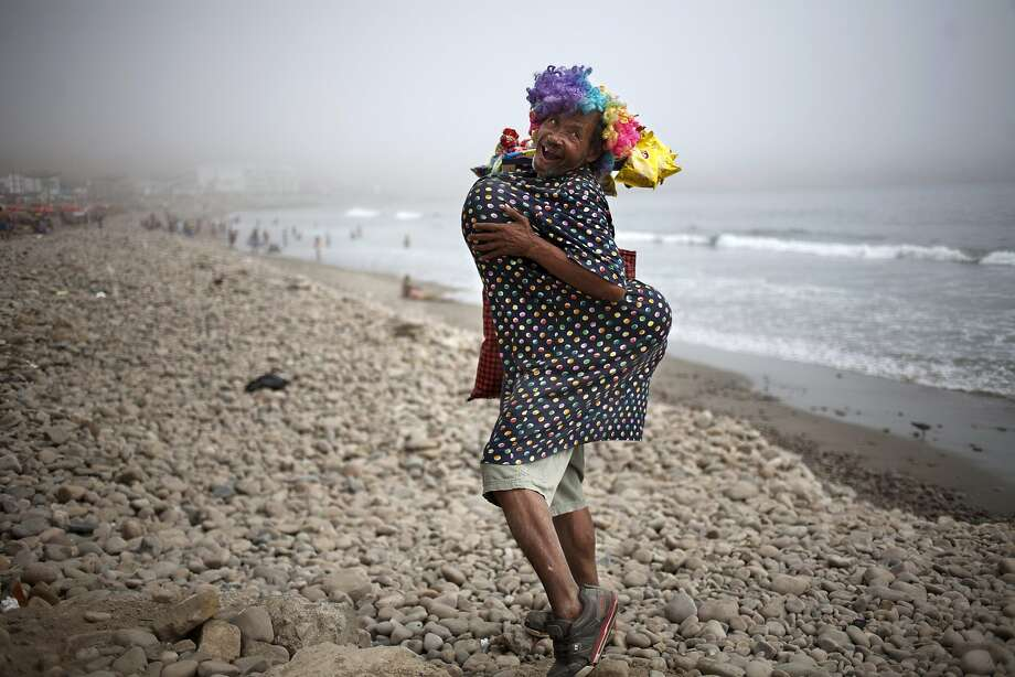Cross-dress for success: Eduardo, a street vendor who sells snacks to beach-goers, strikes 