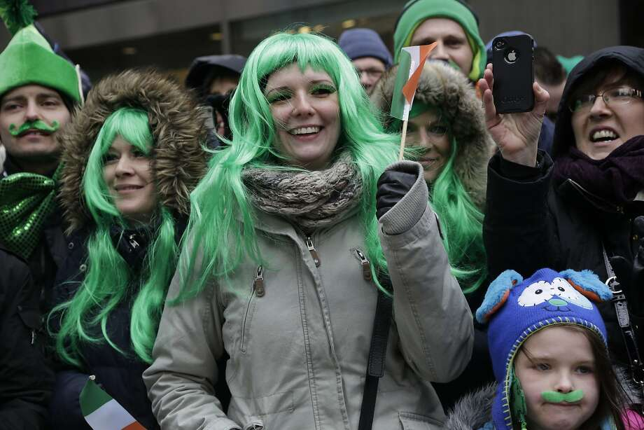 The locks of the Irish: Green-haired colleens watch the St. 