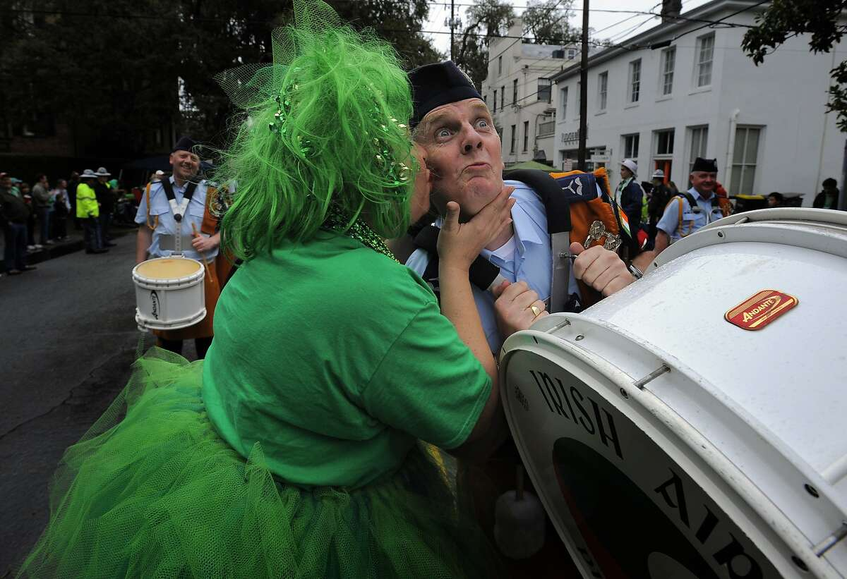 Carolyn Geis, right, kisses Irish Air Corps Pipe and Drum member Terry Healy on the cheek during Savannah's 190-year-old St. Patrick's Day parade, Monday, March 17, 2014, in Savannah, Ga. Kissing men in uniform is a tradition during the celebration in Georgia's first city.