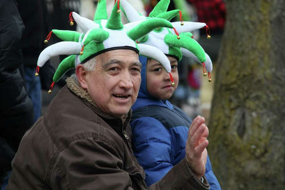 Fasto Jarrim and his grandson Dante, 7, watch the Greater Bridgeport 32nd St.Patrick's Day Parade in downtown Bridgeport, Conn. on Monday, March 17, 2014. Photo: BK Angeletti, B.K. Angeletti / Connecticut Post freelance B.K. Angeletti