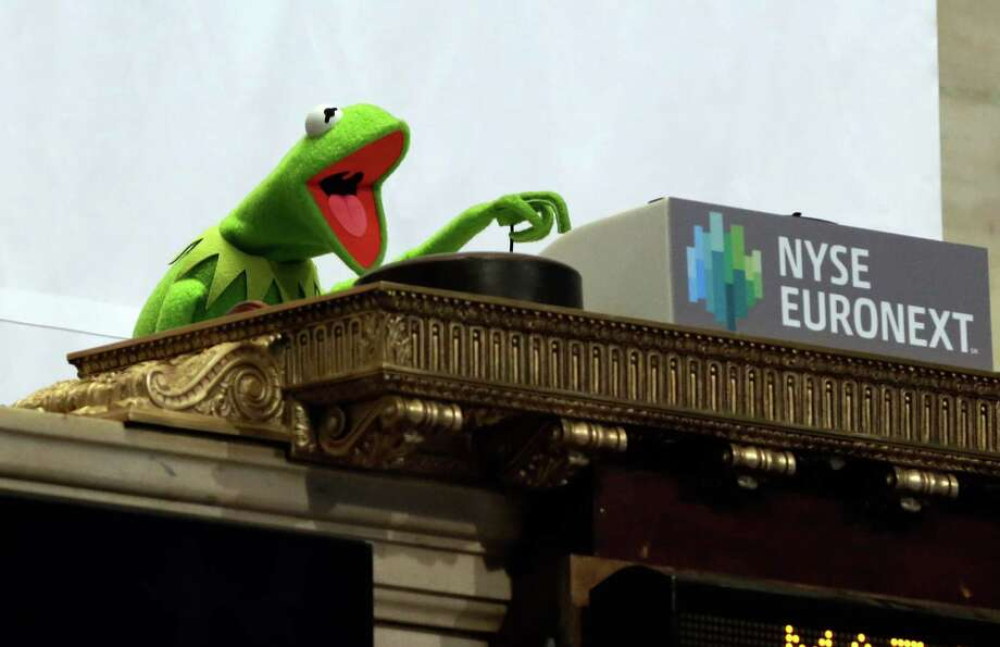"Muppet Kermit the Frog rings the the New York Stock Exchange opening bell, Monday, March 17, 2014, to promote his new movie ""Muppets Most Wanted."" Stocks jumped following news that output at U.S. factories surged last month. Photo: Richard Drew, Associated Press / Associated Press contributed"