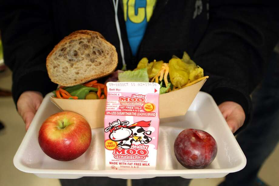 Under new federal guidelines, schools must provide one serving of fruit or vegetables in every school lunch, but most students are throwing it away. Photo: Laraine Weschler, Associated Press