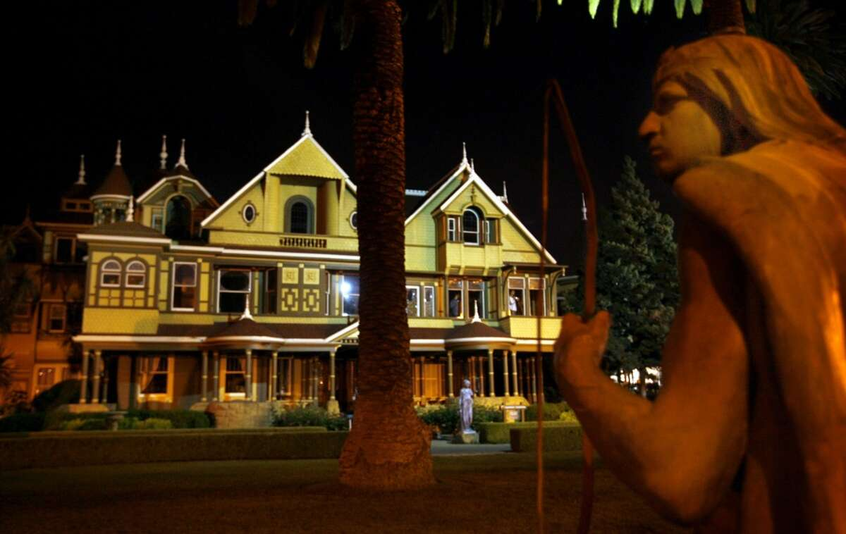 The Winchester Mystery House in San Jose seen at night.