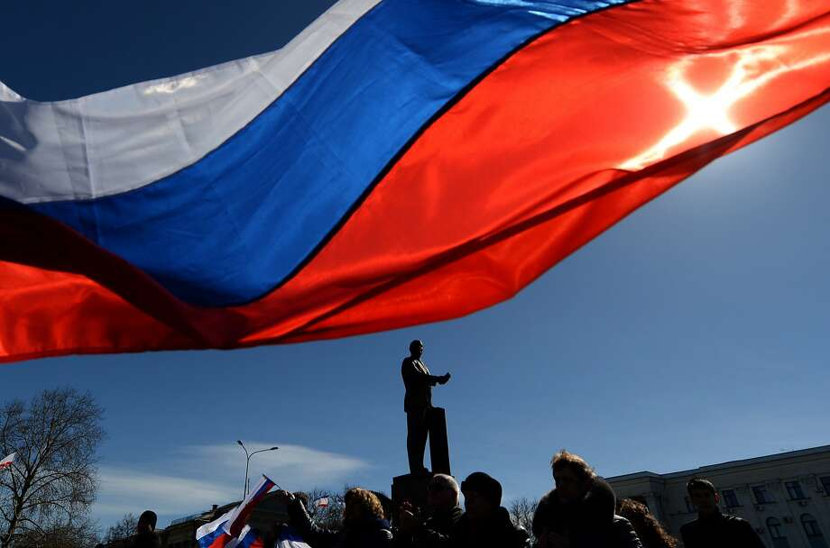 People hold Russian flags as they celebrate in Lenin Square in Simferopol, Crimea's capital. Photo: Vasily Maximov, AFP/Getty Images
