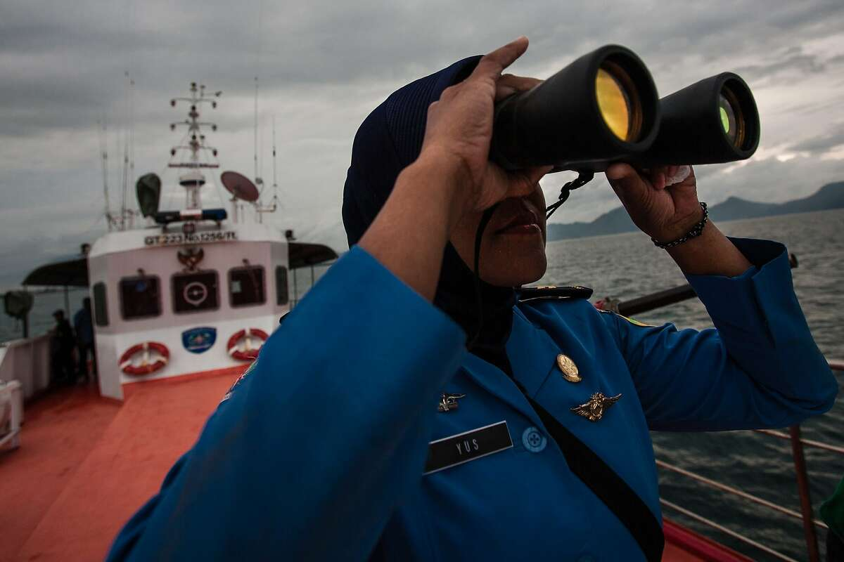A personnel of Indonesia's National Search and Rescue looks over horizon during a search in the Andaman sea area around northern tip of Indonesia's Sumatra island for the missing Malaysian Airlines flight MH370 on March 17, 2014. The last words spoken from the cockpit of the Malaysian passenger jet that went missing 10 days ago were believed to have been spoken by the co-pilot, the airline's top executive said Monday. AFP PHOTO / CHAIDEER MAHYUDDINCHAIDEER MAHYUDDIN/AFP/Getty Images