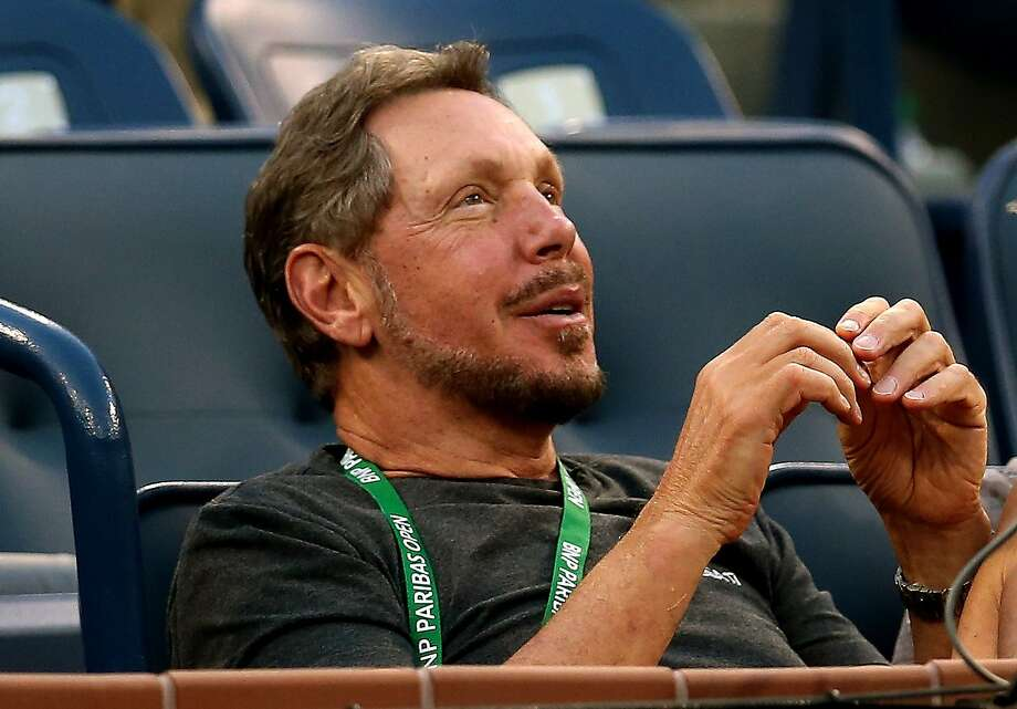 INDIAN WELLS, CA - MARCH 06:  Larry Ellison watches as Lleyton Hewitt of Australia plays Matthew Ebden of Australia during the BNP Paribas Open at Indian Wells Tennis Garden on March 6, 2014 in Indian Wells, California.  (Photo by Stephen Dunn/Getty Images) Photo: Stephen Dunn, Getty Images