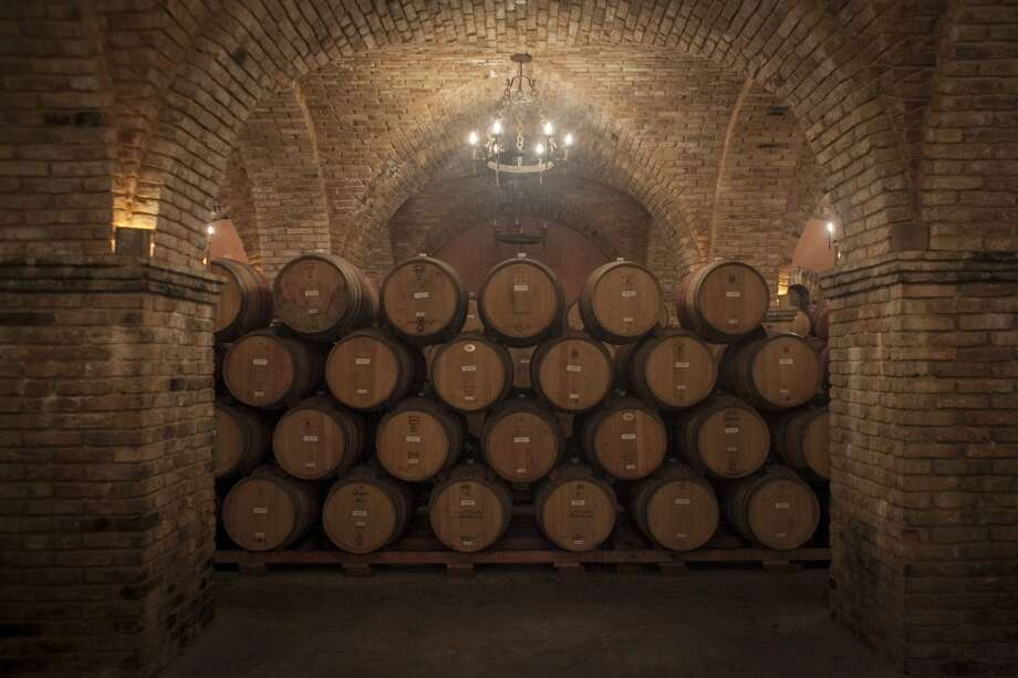 Wine barrels at Castello di Amorosa, a winery located in Calistoga that is a replicated medieval castle. Photo: Special To The Chronicle