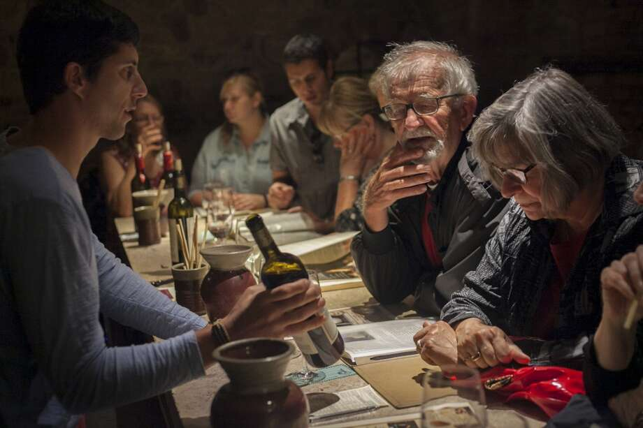 Wine enthusiasts taste various vintages in an underground tasting room at Castello di Amorosa, a winery located in Calistoga that is a replicated medieval castle, on September 30th 2013. Photo: Special To The Chronicle