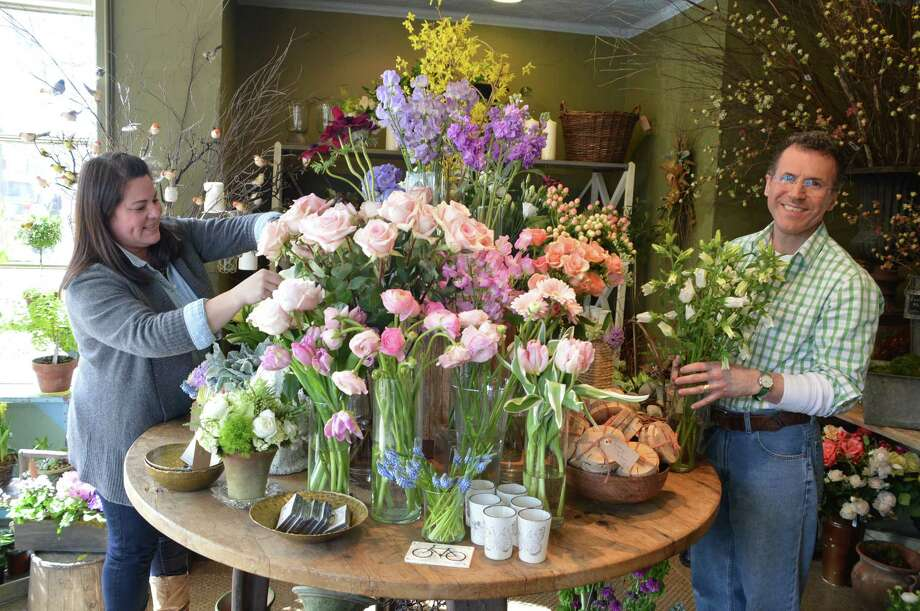 Nancy Whitehurst, store manager, and Kyle Riccoboni, creative director, are thrilled to be seeing new and returning customers in New Canaan now that Earth Garden has moved back and is now open at 89 Elm St. Jarret Liotta/For the New Canaan News Photo: Contributed / New Canaan News Contributed