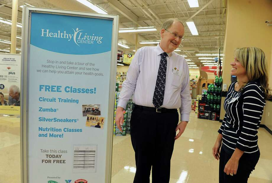 Hannaford store manager Dave Farrell talks to associate relations manager Renee Smith near the Healthy Living Center in his store on Central Ave. on Wednesday, March 12, 2014 in Albany, N.Y.  (Lori Van Buren / Times Union) Photo: Lori Van Buren / 0026102A
