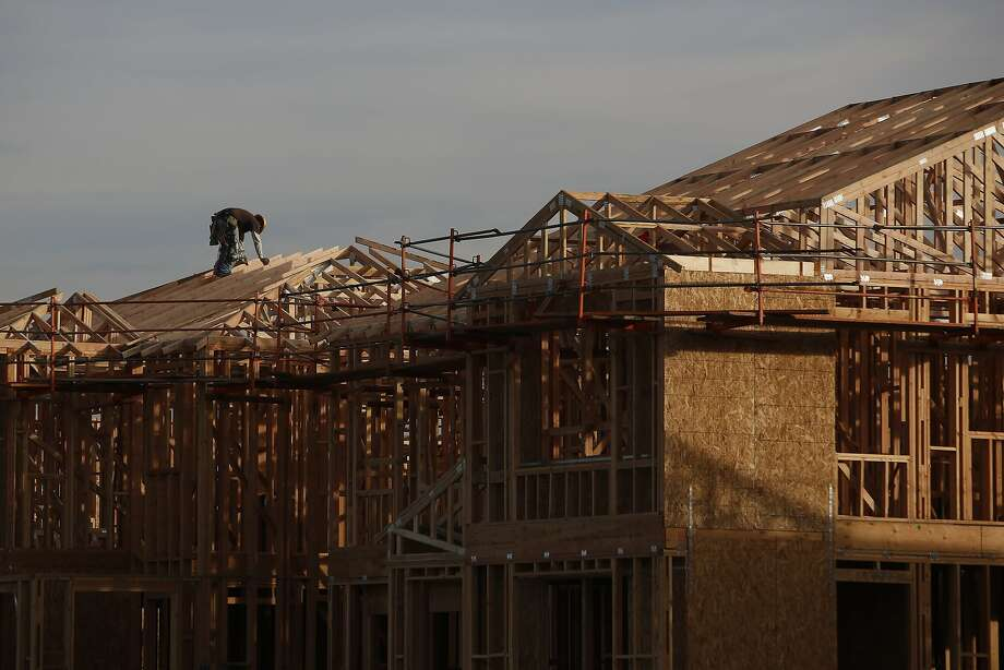 Workers frame new homes in the Baker Ranch community development in Lake Forest. Photo: Patrick T. Fallon, Bloomberg