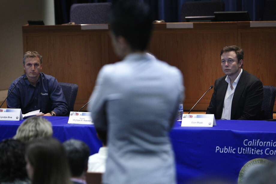 SolarCity CEO Lyndon Rive (left) and board Chairman Elon Musk speak at a forum in S.F. last month. Photo: Lea Suzuki, The Chronicle