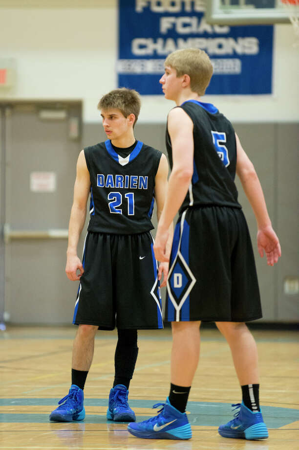 Darien's Matt Staubi (21) stands at mid-court with teammate Bobby Fitzpatrick (5) during a boys basketball game against New Canaan at Darien High School on Thursday, Feb. 20. Photo: Amy Mortensen / Connecticut Post Freelance