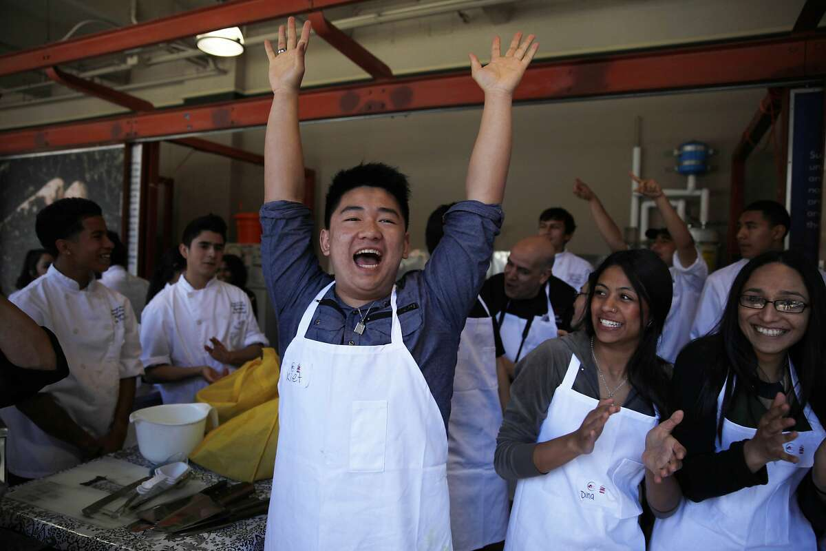 Kiet Huynh, 18, Galileo High School senior, raises his hands in the air after it was announced that the chicken dish the team he was on took the award for best tasting as students from San Francisco's Galileo High School and Concord's Mt. Diablo High School competed in The Bay Bridge Teens Cook with Heart Challenge at the Ferry Building on Monday, March 17, 2014, in San Francisco, Calif.
