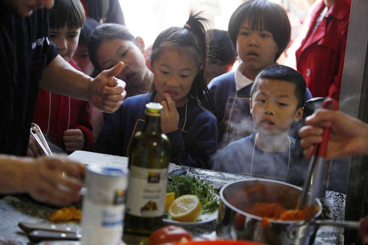 Above: Second- and third-grade students from John Yehall Chin Elementary School watch as students compete in the American Heart Association's Teens Cook With Heart Bay Bridge Challenge in S.F.