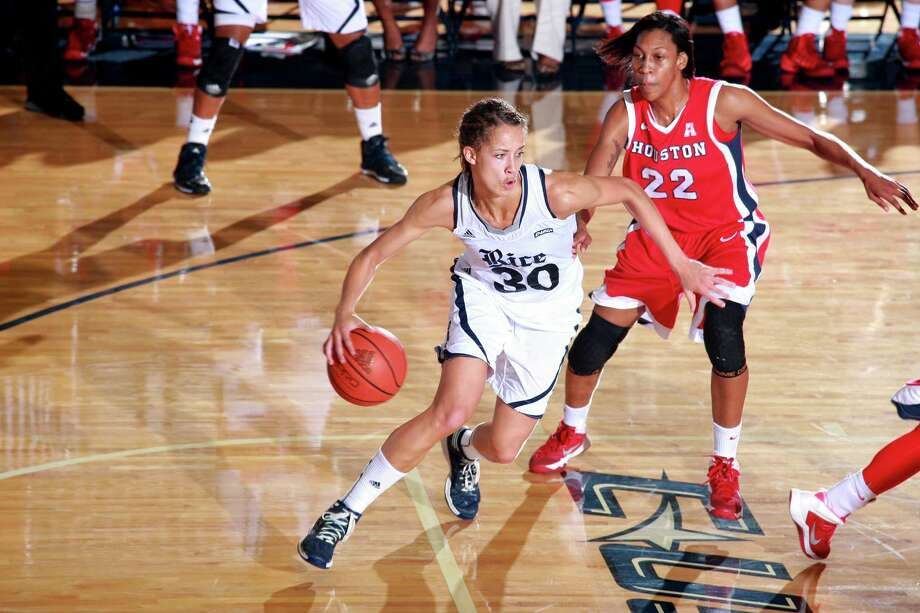 Rice University guard Jessica Kuster, left, moves the ball downcourt during a game against Houston. The Reagan High School graduate not only set Conference USA records for double-doubles and rebounds over her career, she was also the first player to make all-conference first team and all-defensive team for four years. Photo: Courtesy, Rice University