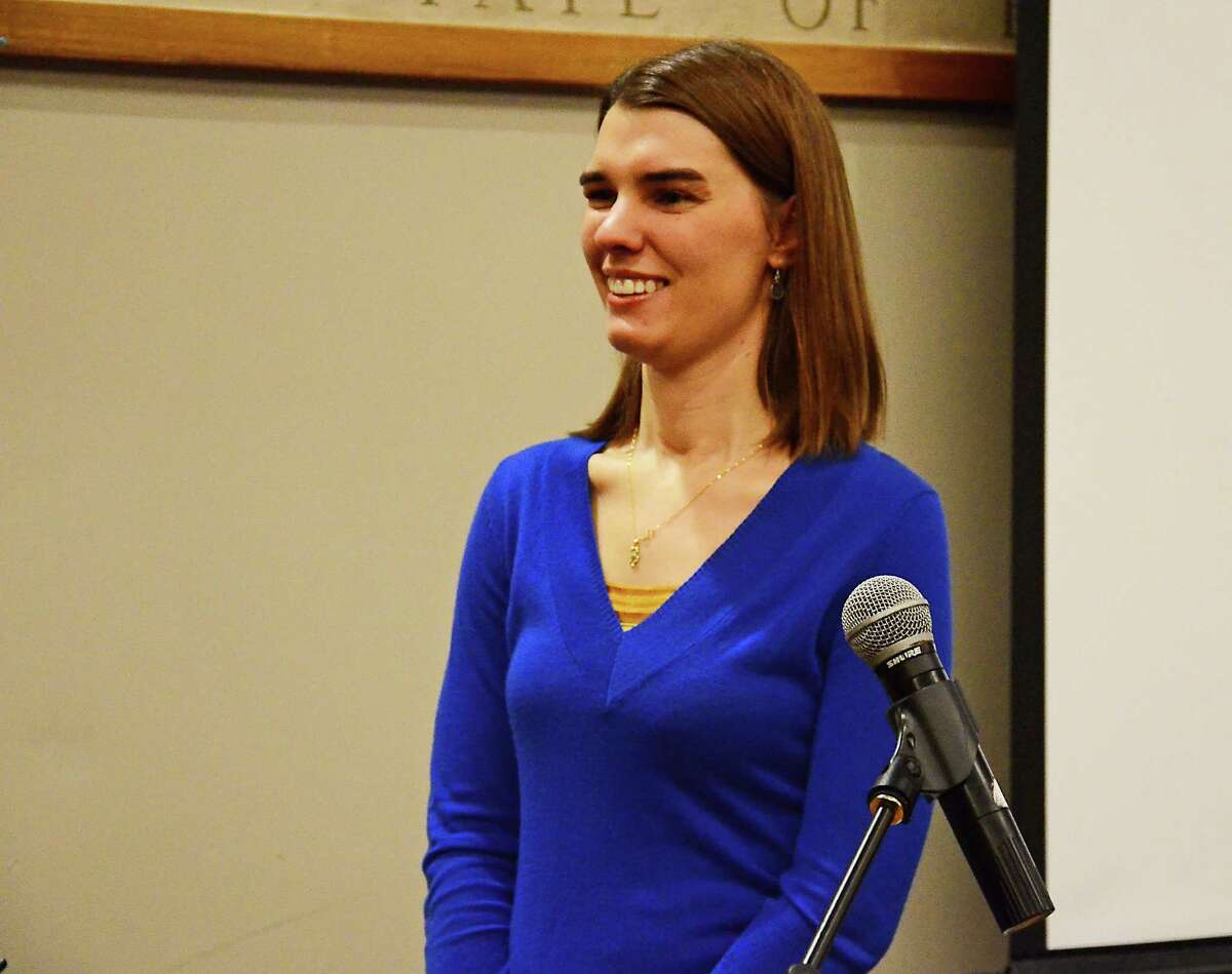 Jacy Good tells New Canaan High School students and parents March 12, 2014, about an accident caused by a distracted driver that killed her parents and left her with a traumatic brain injury.