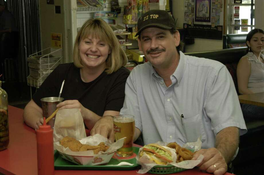 Belinda and Steve Christian.  Steve Christian a third generation owner of Christian's Tailgate, a great hamburger place on Washington Ave. at Interstate 10 located in near northwest Houston.  09/04/2004   (E. Joe Deering/Chronicle) Photo: E. Joseph Deering, Houston Chronicle / Houston Chronicle