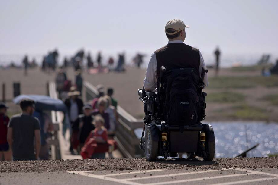 Larry Paradis takes in the view from the farthest point wheelchair users can go at Fort Cronkhite in the Marin Headlands. Photo: Andre Zandona, The Chronicle