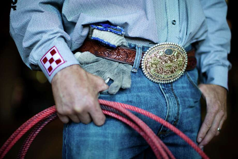 Team roper Turtle Powell wears his 2011 World Champion Header buckle for the 2014 Houston Rodeo. Photo: Marie D. De Jesus, Staff / © 2014 Houston Chronicle