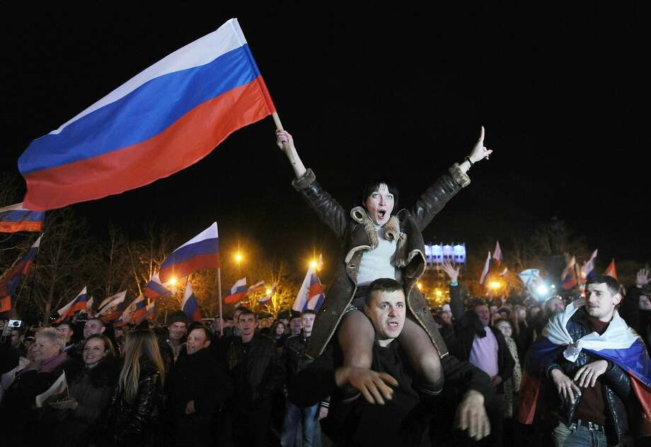 Back in the U.S.S.R.: Pro-Russian Crimeans celebrate in Sevastopol after exit polls 