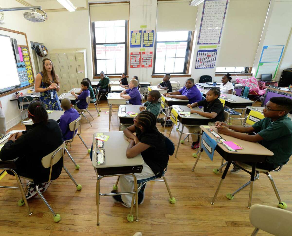 Teacher Lindsey Marquit works with students in her class at the Ark Community Charter School in Troy, N.Y. Sept. 7, 2012. (Skip Dickstein/Times Union archive)