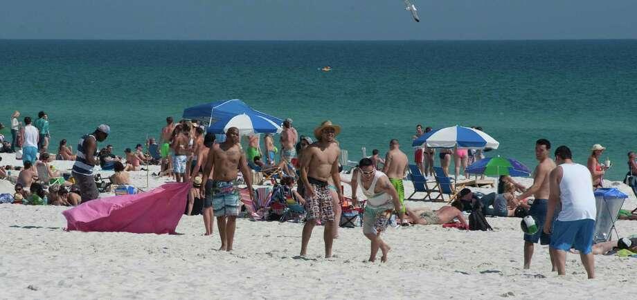 Warm weather draws spring beakers and locals to Pensacola Beach at Pensacola Beach in Pensacola, Fla.  on Monday, March 10, 2014. (AP Photo/The Pensacola News Journal, Tony Giberson) Photo: Tony Giberson, AP / The Pensacola News Journal
