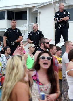 Panama City Beach Police Officers watching over a large crowd of spring breakers on March 11, 2014,  during a Luke Bryan concert in Panama City, Fla. Photo: Andrew Wardlow, AP / Panama City News Herald/Panama City, FL