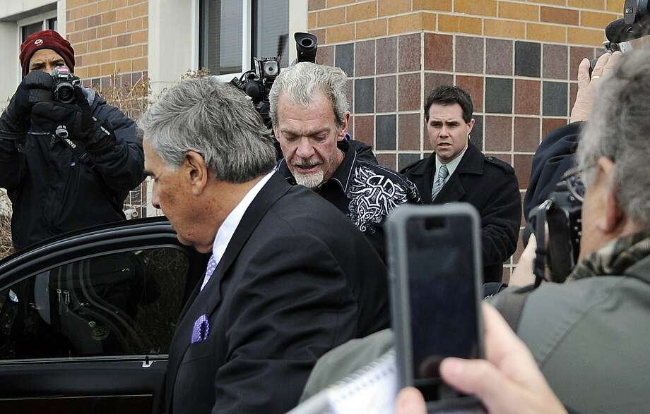 Indianapolis Colts owner Jim Irsay (center) and his attorney, James Voyles, leave the Hamilton County Jail after Irsay was released following a DUI arrest. Photo: Alan Petersime, Associated Press