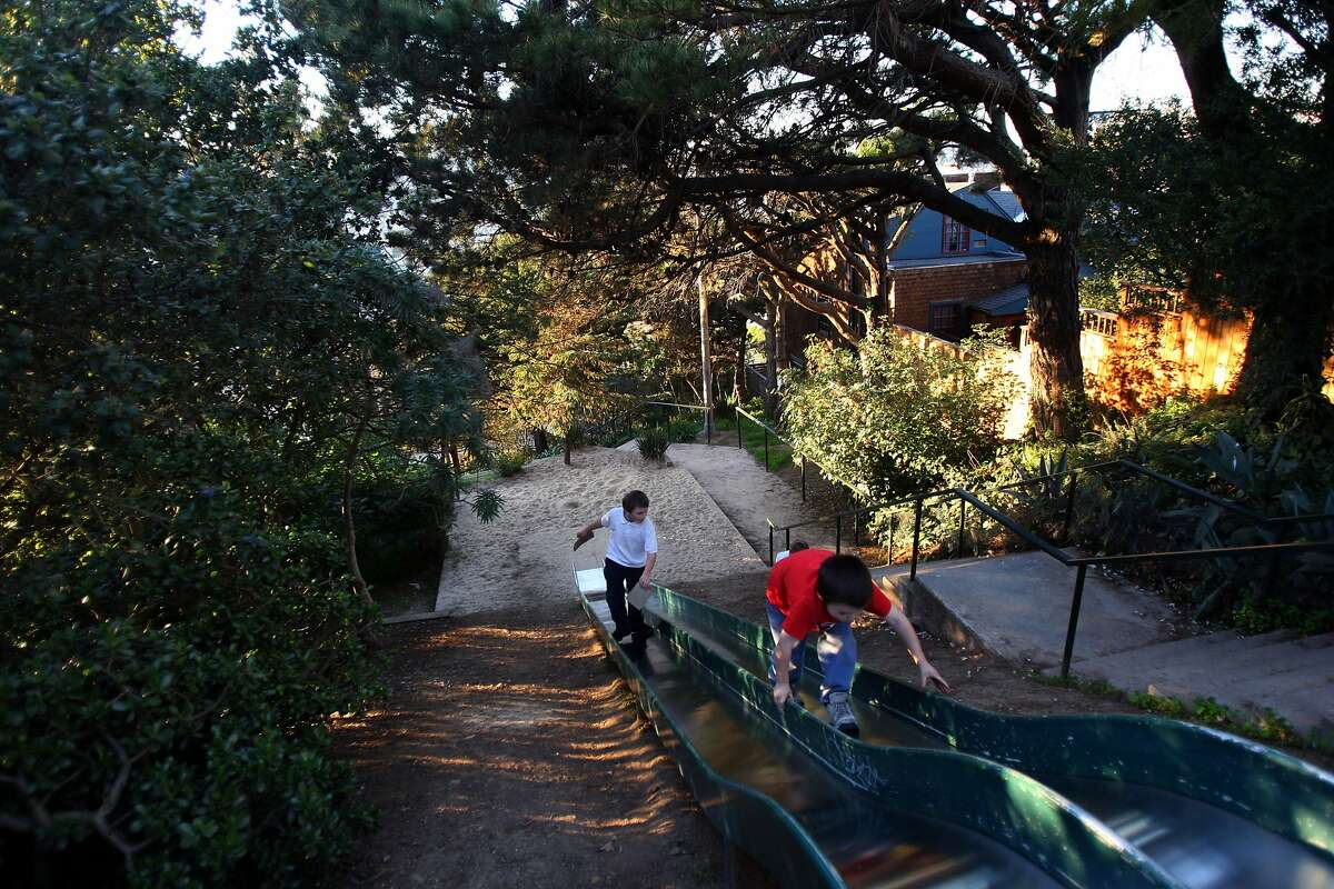 The Winfield Street slides are entirely hidden by trees. This steep joy ride can be found near Winfield Street and Esmeralda Avenuein Bernal Heights.Pictured: 8-year-old Darragh Long (right) and 8-year-old Michael Cordobes (left), from San Francisco walk up the slides on January 15, 2009. Google map