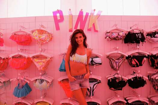 And now for a word from a Spring Break sponsor ... (JK! ... sort of) Victoria's Secret PINK Model Sara Sampaio host PINK Nation Spring Break Beach Party on March 13, 2014 in Destin, Florida. Photo: Don Juan Moore, Getty Images / 2014 Getty Images