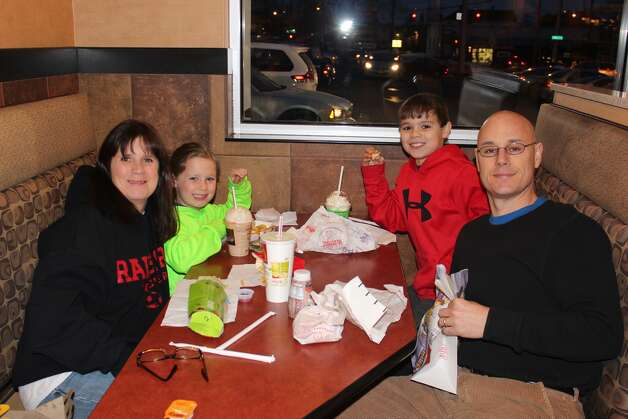 """The Basaillon family dines at the Mechanicville McDonald's on March 4 as teachers and members of the Mechanicville Elementary School PTA wait on students and patrons to raise money for their school on """"McTeacher's Night."""" A percentage of proceeds from the food and beverage sales during the 21/2-hour fundraiser raised $860. (Submitted photo)"""
