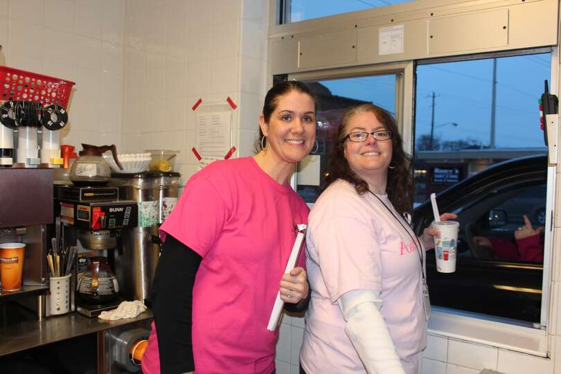Mrs. LaShomb and Mrs. Krajewski, members of the Mechanicville PTA, pitch in at the McDonald's drive-