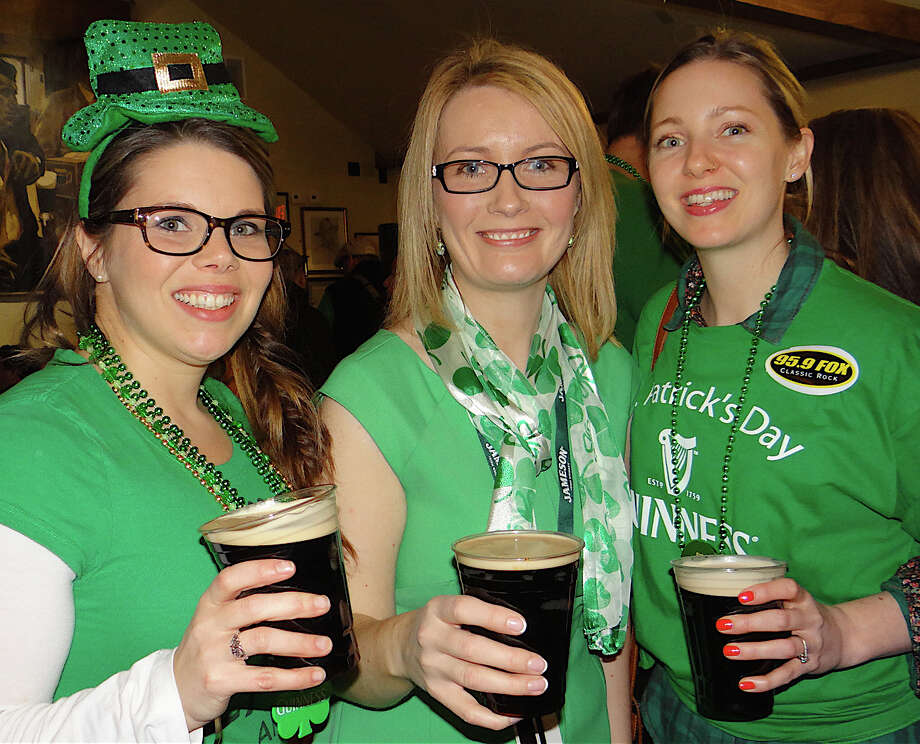 Caroline Cullimore, center, manager of Anna Liffey's pub downtown, with Shannon Kinney, of Norwalk, and Laura Kinney, of Brooklyn, N.Y., celebrating St. Patrick's Day on Monday afternoon. Photo: Mike Lauterborn / Fairfield Citizen