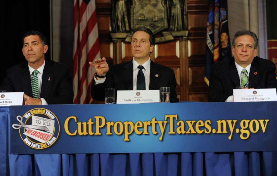 Gov. Andrew Cuomo is joined by Michael Hein, Ulster County Executive, left, and Edward Mangano, Nassau County Executive, right, to talk about a property tax freeze Monday, March 17, 2014, at the Capitol in Albany, N.Y.  (Lori Van Buren / Times Union) Photo: Lori Van Buren / 00026187A