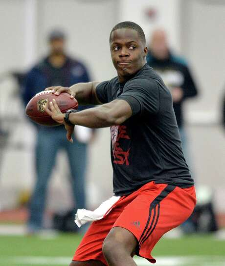 Teddy Bridgewater completed 71 percent of his passes as a junior, but his throwing motion has its critics. Photo: Timothy D. Easley, FRE / FR43398 AP