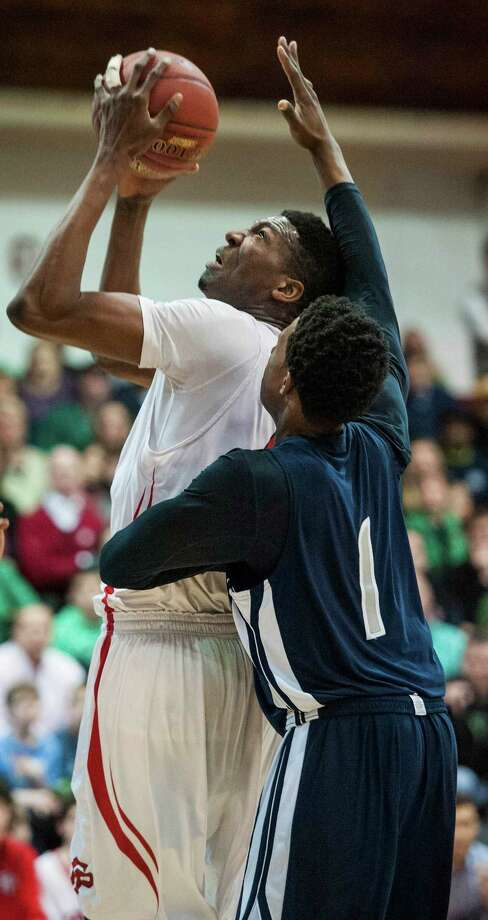 Fairfield Prep high school's Paschal Chukwu goes up for a shot during a CIAC class LL tournament quarterfinal game against Hillhouse high school played at Alumni Hall, Fairfield University, Fairfield, CT on Monday, March, 17th, 2014. Photo: Mark Conrad / Connecticut Post Freelance