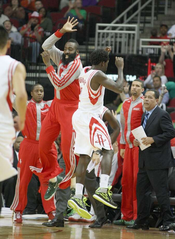 March 17: Rockets 124, Jazz 86  Rockets guard James Harden celebrates with Patrick Beverley after Beverley hit a three pointer. Photo: Johnny Hanson, Houston Chronicle
