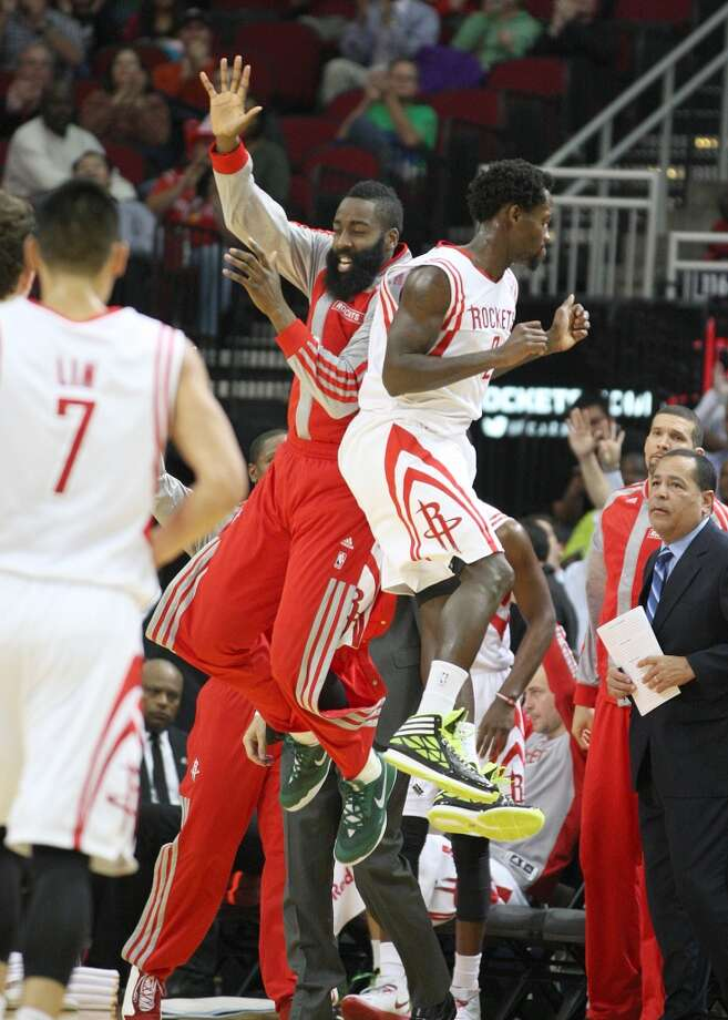 Rockets guard James Harden celebrates with Rockets guard Patrick Beverley after Beverley hit a three pointer. Photo: Johnny Hanson, Houston Chronicle