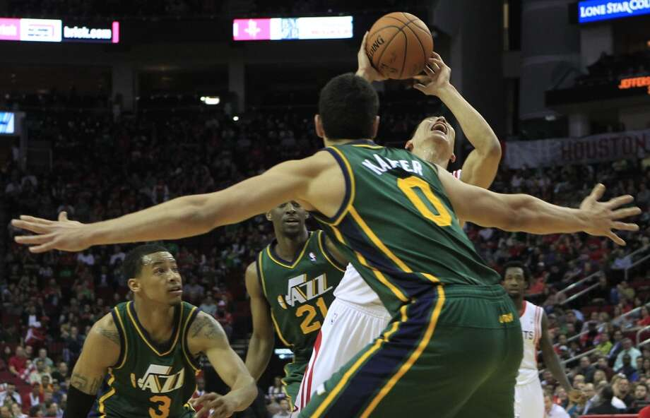 Rockets guard Jeremy Lin attempts to make a basket while defended by Jazz center Enes Kanter, guard Trey Burke and guard Ian Clark. Photo: Johnny Hanson, Houston Chronicle