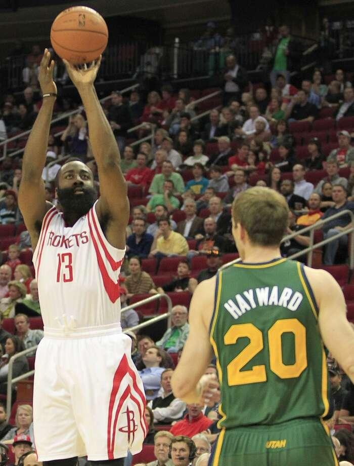 Rockets guard James Harden puts up a three-pointer. Photo: Johnny Hanson, Houston Chronicle