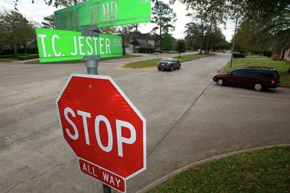 Cars move through the intersection of T.C. Jester Blvd. and Aspen Bend Dr. Monday, March 17, 2014, in Houston. A number of traffic lights are planned to be installed along T.C. Jester Blvd. between FM 1960 and FM 2920. ( Melissa Phillip / Houston Chronicle )