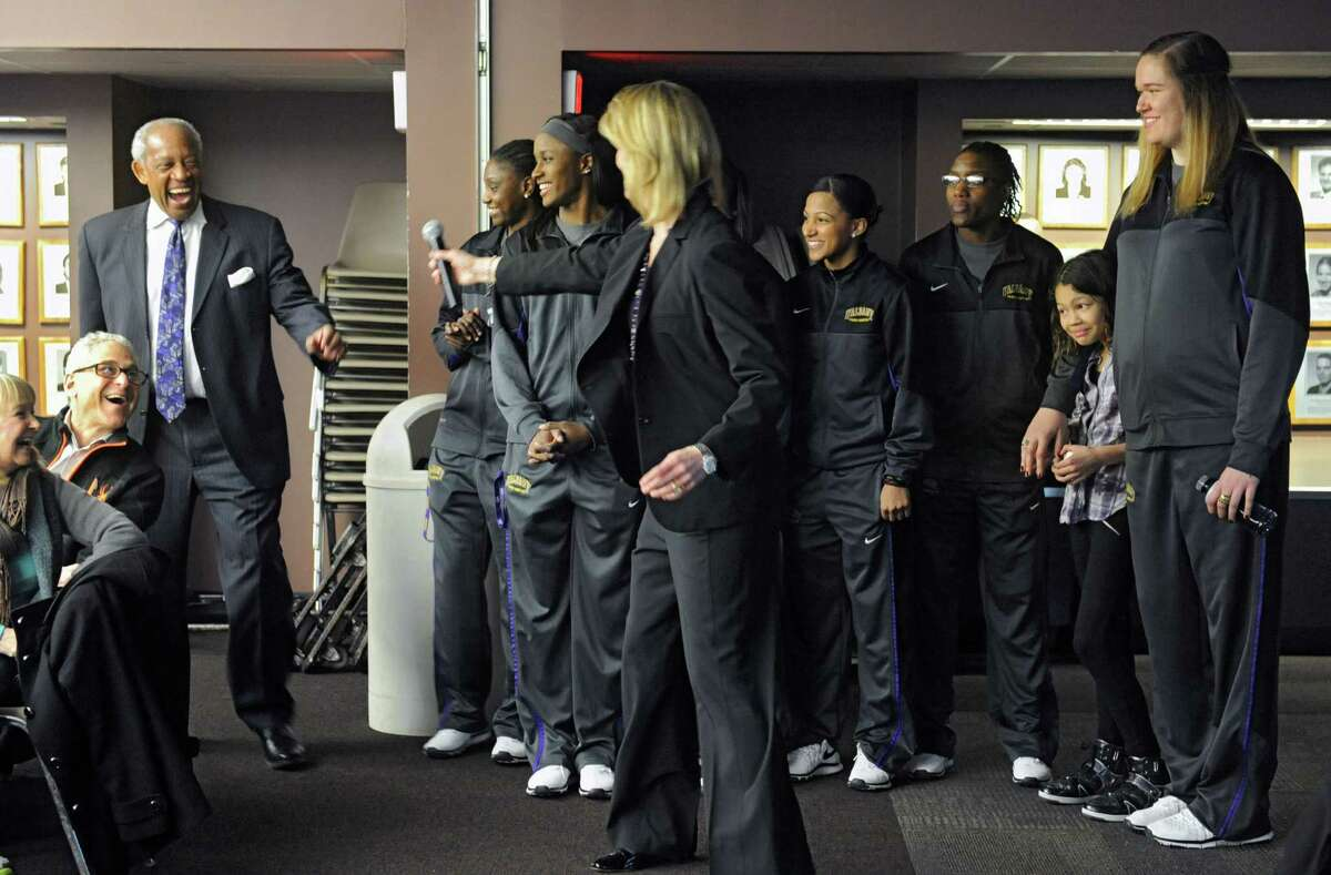 University at Albany women's basketball head coach Katie Abrahamson-Henderson hands off the microphone to Lee McElroy, Director of Athletics, to say a few words before finding out their team will be playing West Virginia at Baton Rouge in the NCAA Tournament during a selection show party at the SEFCU arena on Monday, March 17, 2014 in Albany, N.Y. (Lori Van Buren / Times Union)
