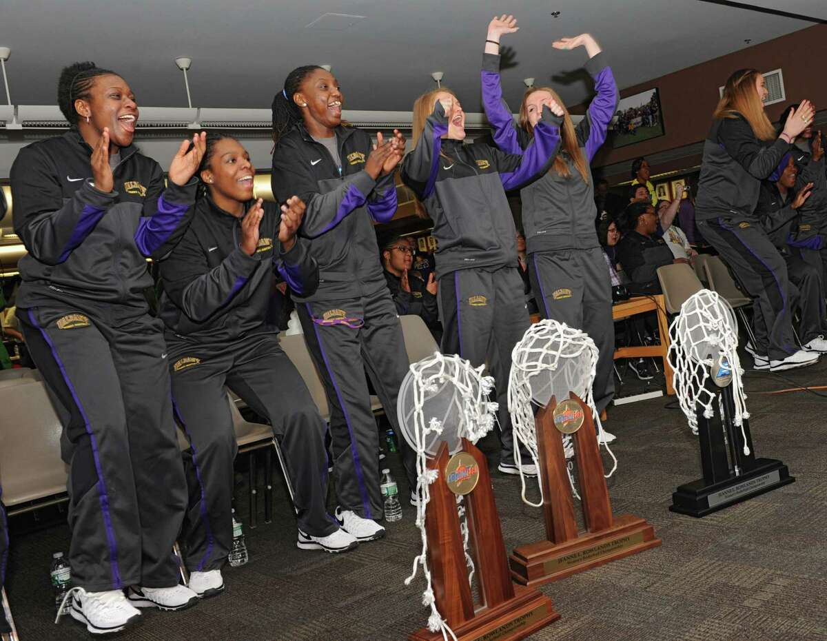 The University at Albany women's basketball team reacts as they find out they're playing West Virginia at Baton Rouge in the NCAA Tournament during a selection show party at the SEFCU arena on Monday, March 17, 2014 in Albany, N.Y. Pictured here from left are Zaklya Saunders, Jessica Fequiere, Bose Aiyalogbe, Erin Coughlin, Sarah Royals, Megan Craig, Shereesha Richards and Tammy Phillip. (Lori Van Buren / Times Union)