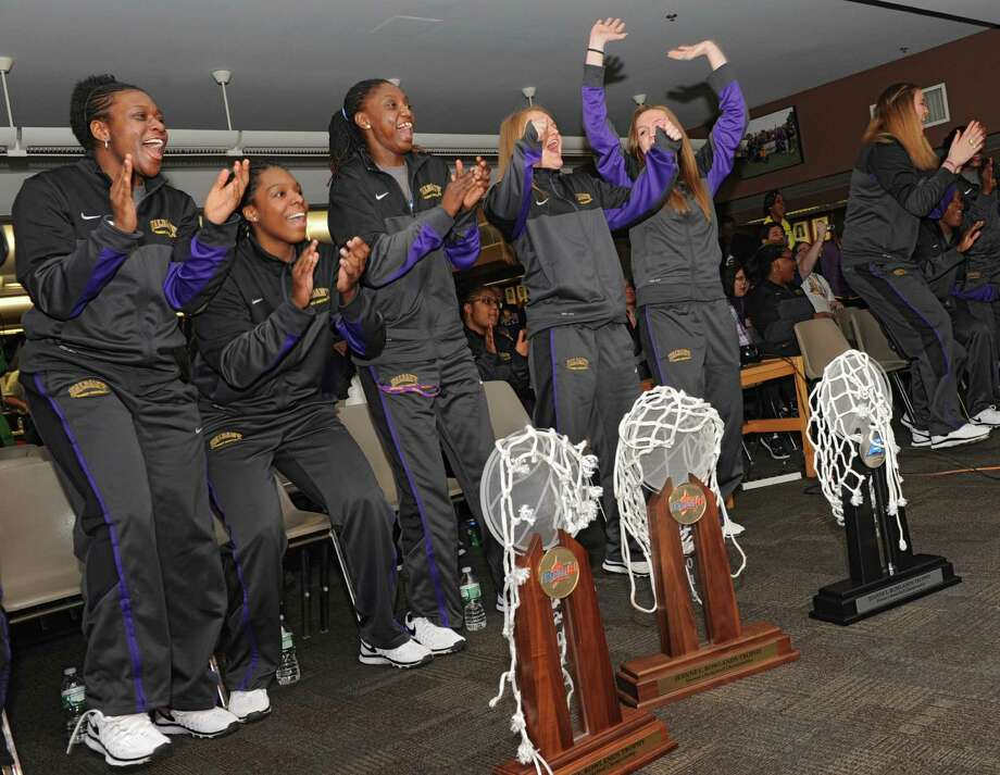 The University at Albany women's basketball team reacts as they find out they're playing West Virginia at Baton Rouge in the NCAA Tournament during a selection show party at the SEFCU arena on Monday, March 17, 2014 in Albany, N.Y. Pictured here from left are Zaklya Saunders, Jessica Fequiere, Bose Aiyalogbe, Erin Coughlin, Sarah Royals, Megan Craig, Shereesha Richards and Tammy Phillip.  (Lori Van Buren / Times Union) Photo: Lori Van Buren / 00026163A