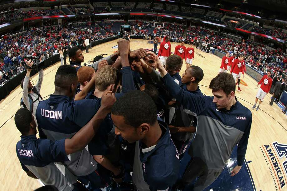 MEMPHIS, TN - MARCH 15: The Connecticut Huskies huddle together before a game against the Connecticut Huskies during the Championship of the American Athletic Conference Tournament at FedExForum on March 15, 2014 in Memphis, Tennessee. Louisville defeated Connecticut 71-61. (Photo by Joe Murphy/Getty Images) ORG XMIT: 477024465 Photo: Joe Murphy / 2014 Getty Images