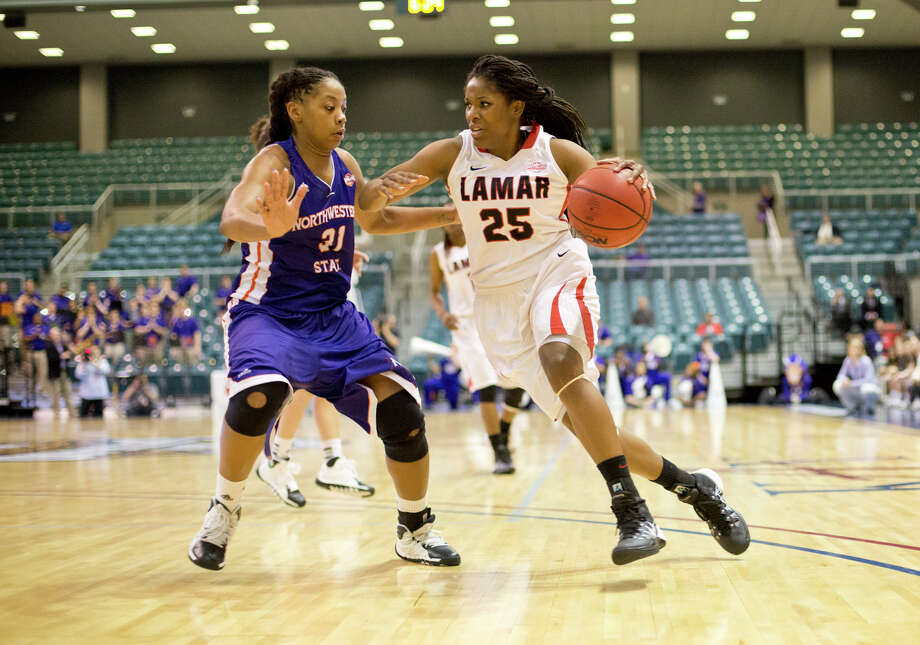 Lamar's Dominique Edwards, No. 25, drives past a defender during the 61-60 loss to Northwestern State March 15, 2014 in the Merrell Center in Katy, TX. (Matt Billiot / Special to the Enterprise)